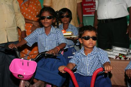 Schoolgirls with new tricycles 		                             copyright © Hamara Bandhan e.V.