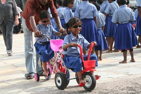 first time on a new tricycle 		                             copyright © Hamara Bandhan e.V.