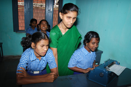 blind girls with the Braille typewriter 		                             copyright © Hamara Bandhan e.V.
